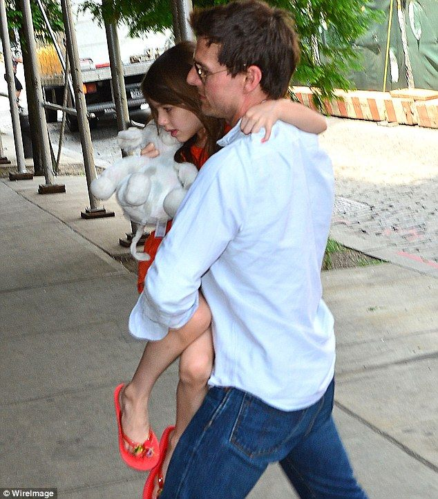 Daddy's girl: Tom Cruise and daughter Suri reunited in New York today