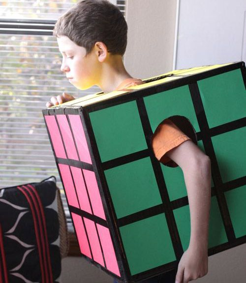 With just a box and some construction paper, a quirky kid can impress friends as this infamous puzzler from yesteryear. Bonus points if he or she can actually solve one!  Complete How-To: Rubix Cube Costume   - CountryLiving.com