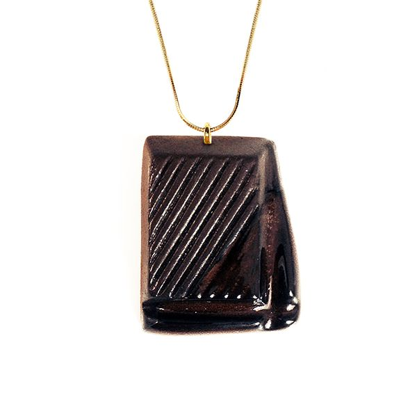 This piece of chocolate pendant looks real in size and texture, and even smells like a real dessert, but is handcrafted from clay using high-quality materials and fired up to two times. #jewelry #pendant #doughnut #dessert #chocolate #accessory #fashion  #handmade  Find it at http://www.mokosh.dk/our-talents/tadam/