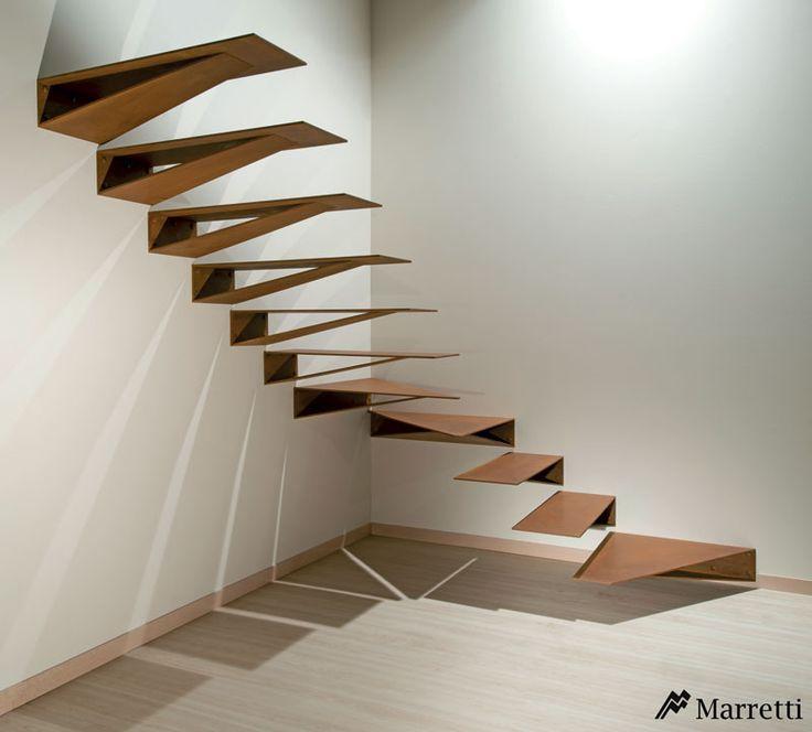 """MARRETTI - Escalier à encorbellement modèle """"Origami"""" en acier Cor-Ten."""