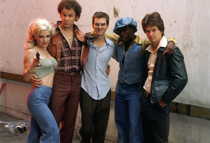 """On the set of """"Boogie Nights"""", 1997.  L to R: Melora Walters, John C. Reilly, writer/director Paul Thomas Anderson, Don Cheadle, Mark Wahlberg."""