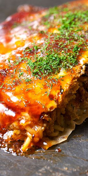 Japanese food - Okonomiyaki, Hiroshima-style. And Hiroshima-style is ...