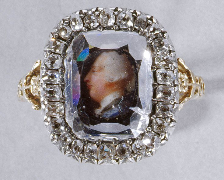 Ring with a miniature of George III. 1761. Gold, diamonds, miniature on ivory. Provenance:  Presented to Queen Charlotte by George III on their wedding day, 8 September 1761; left the Collection; reacquired by the future King George V & Queen Mary; by whom presented to King Edward VII on his birthday, 9 November 1909.