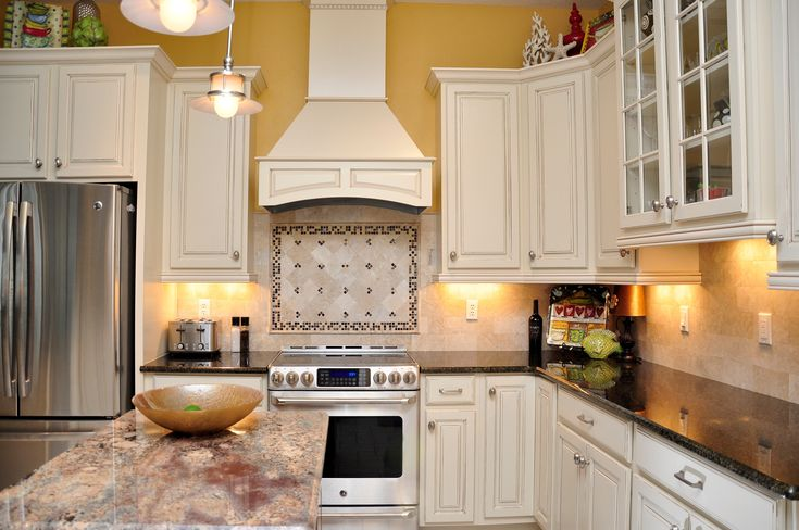 yellow kitchen tile white cabinets granite stainless steel appliances 1221