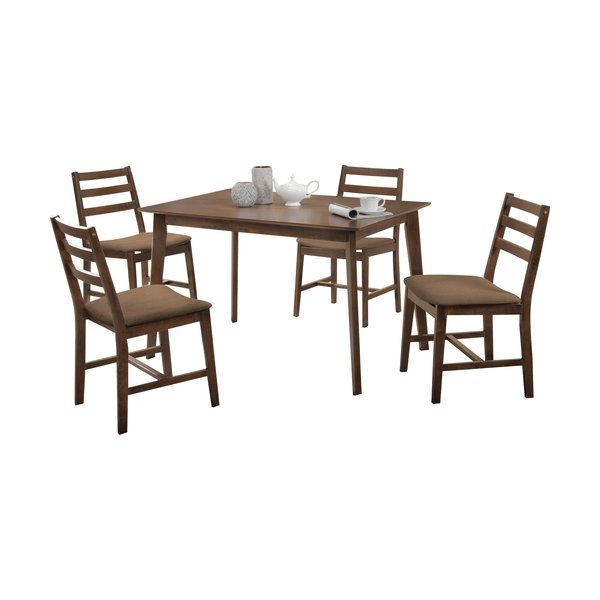 This Pascual 5 Piece Counter Height Dining Set offers simple sophisticated style for your casual transitional dining room. This set comes in the sturdy wooden frame which guarantees the long-term usage. Slatted backrest and upholstered seat cushions create comfortable touches for everyday use.