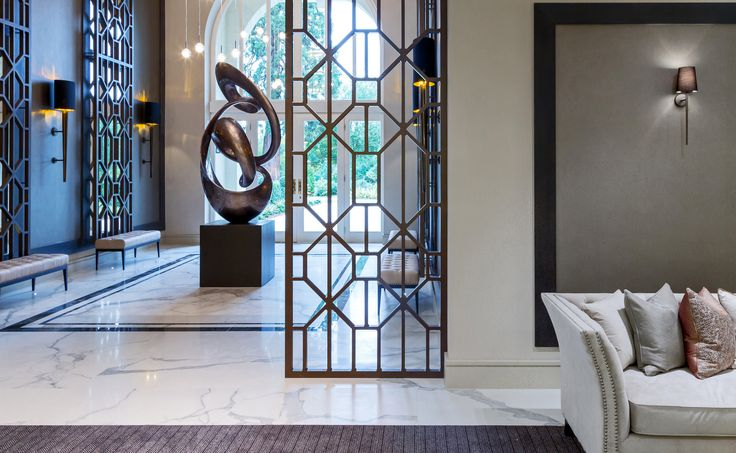 Unique in its beauty, we used contemporary styling and bespoke lighting to enhance the copper tones and abstact architectural detailing of this Millgate development, creating a classic and luxurious feel. Architecture by @ascotdesign0779.