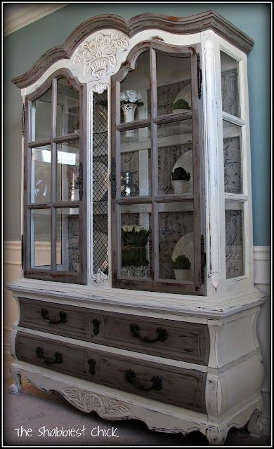 I am not a shabby-chic girl, but this hutch is fantastic! Love the fabric backing! I know people who would pay 2 grand for this but this gal did it for 75 + supplies.