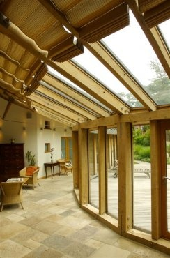 Curving engineered oak frame to contemporary garden house in Kent