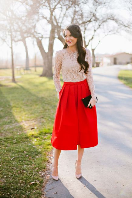 The nude top beautifully offsets the statement red skirt and makes this look appropriate for day or night. #christmas #party #outfits