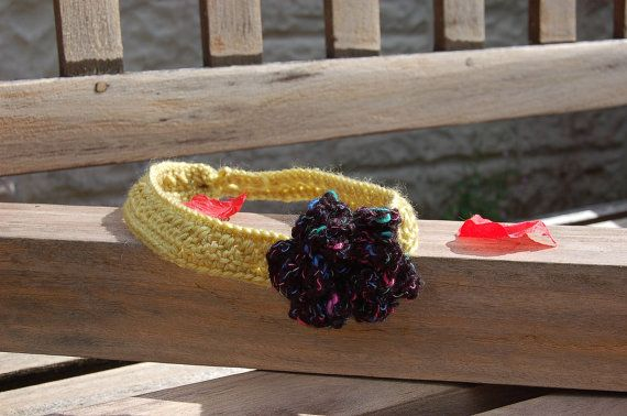Choker with black and multicolour flower https://www.etsy.com/uk/listing/241767056/choker-featuring-multi-coloured-flower