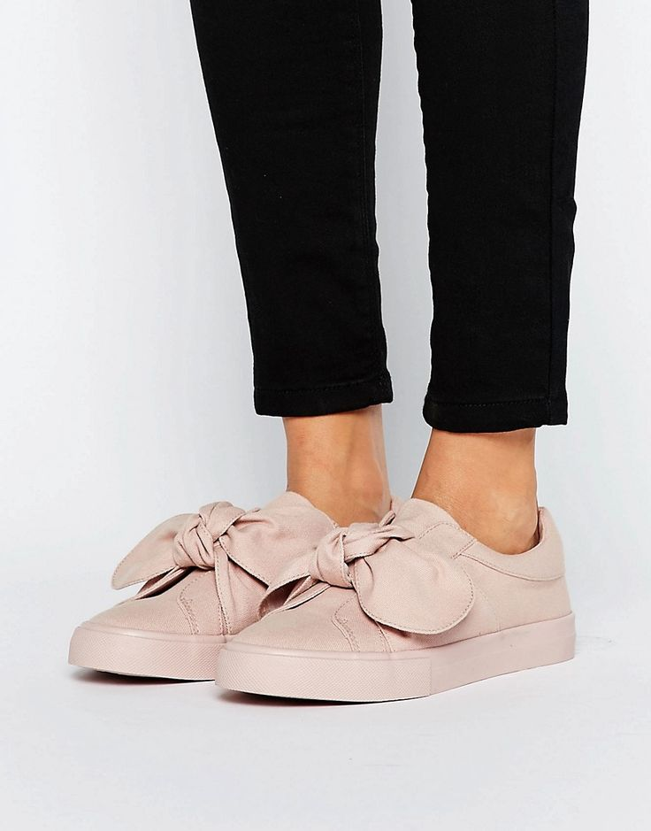 Buy it now. ASOS DOUGHNUT Bow Trainers - Beige. Trainers by ASOS Collection, Textile upper, Slip-on design, Bow detail, Padded for comfort, Moulded tread, Wipe with a damp sponge, 100% Textile Upper. ABOUT ASOS COLLECTION Score a wardrobe win no matter the dress code with our ASOS Collection own-label collection. From polished prom to the after party, our London-based design team scour the globe to nail your new-season fashion goals with need-right-now dresses, outerwear, shoes and denim in…