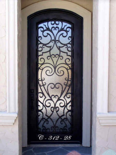Love the look of the iron doors, but only have a single door entryway?  No problem!  We have many single door iron door designs to choose from.  iron doors. wrought iron. custom iron. home remodel. home improvement. home builder. front door.