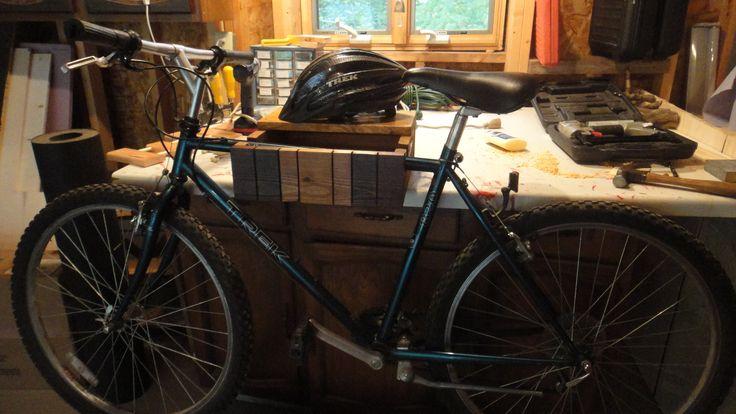 Wall mounted bike rack with shelf