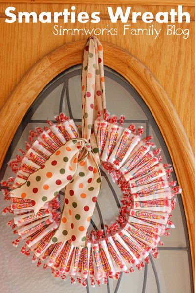 Smarties Wreath - Unexpected Halloween wreath craft that's colorful and sweet. From Simmworks Family Blog.