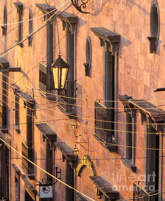 Balconies And Wires At Sunset. View of balconies and windows at dusk in San Miguel de Allende, Mexico.  Fine Art Photography  http://rob-huntley.artistwebsites.com  © Rob Huntley