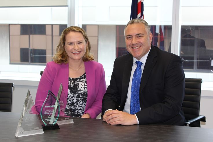 Australia's Treasurer Joe Hockey congratulates Claire Mackay on her 2015 Money Management Financial Planner of the Year, 2014 IFA Investment Adviser of the Year, and 2014 IFA Excellence awards.