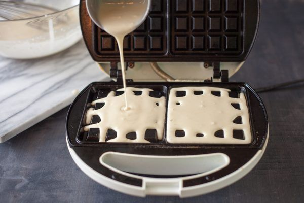 You can make waffles from scratch, from waffle mix or from pancake mix. It's unnecessary to purchase both waffle and pancake mix, when pancake mix makes delicious waffles. Waffles are made of a richer batter than pancakes, with an additional egg and oil. In fact, most pancake mixes offer directions for creating waffles out of the mix.