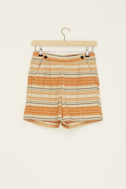 Orange, navy & ivory printed high waisted shorts. Elastic waistband. Button detail. Pockets.