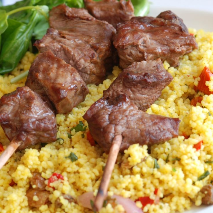 These Moroccan kebabs are served with a simple couscous salad that can be served warm or cold. Great for a backyard meal.