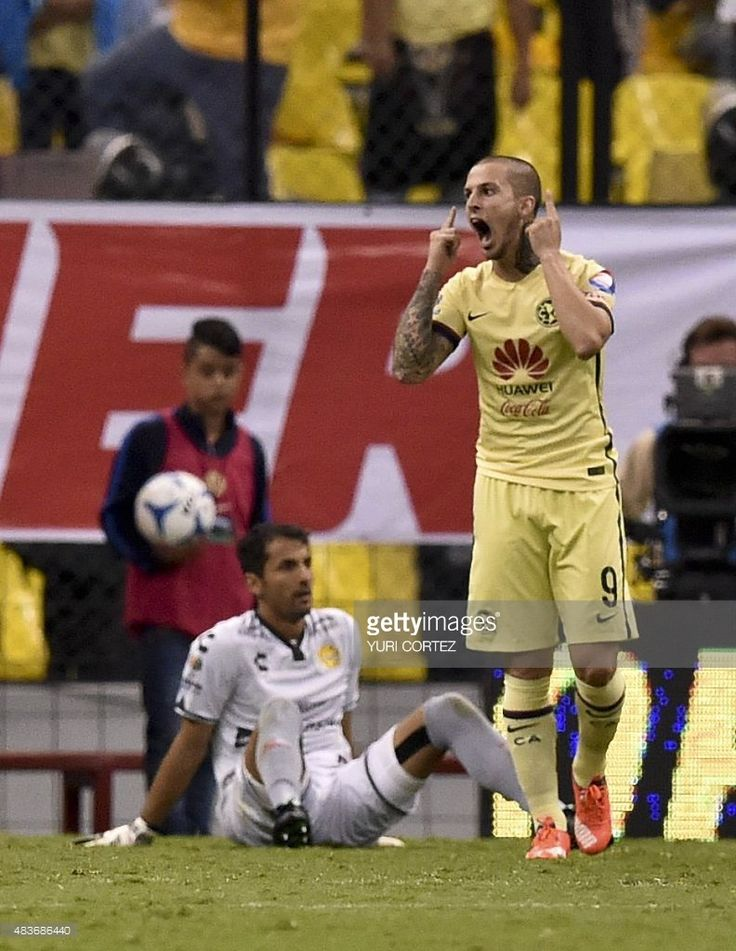 America's forward Dario Benedetto (R) celebrates after scoring a goal next to Dorados goalkeeper Luis Michel (L) during their Mexican Apertura tournament football match against Dorados at the Azteca stadium on August 11, 2015 in Mexico City. America won the match 4-0. AFP PHOTO/ Yuri CORTEZ