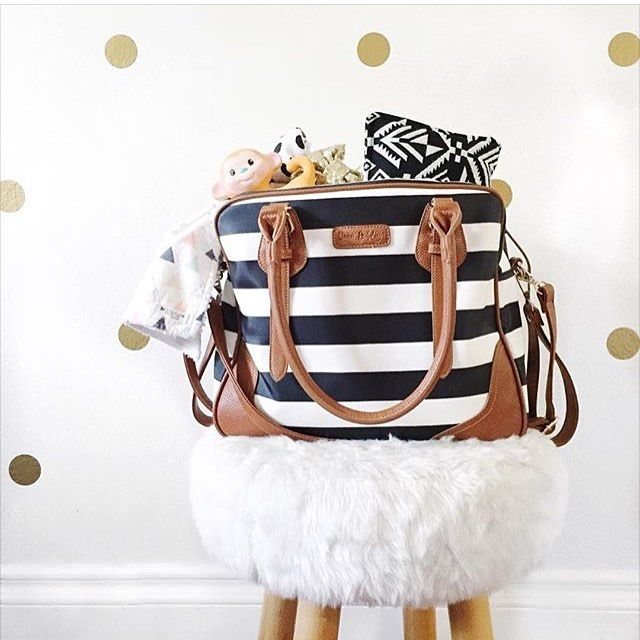 G I V E A W A Y @baby_jules_boutique is in love with our diaper bag!! It's definitely a mommy must have! It fits all those baby items and has a ton of pockets so you stay organized. I especially love the two handles on the sides which make hanging on your stroller a breeze but my favorite thing is the zip out bag. I fill it with my diapers wipes and lotions so diaper changes are literally a breeze. Plus it's so cute and stylish which is an obvious plus I use it even when I'm out without…