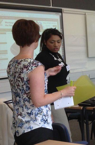 Course leader Amy Maher helps Ayisha Khurshid