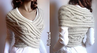 over-sized knitted cowl in cable pattern  worn as body-wrap.