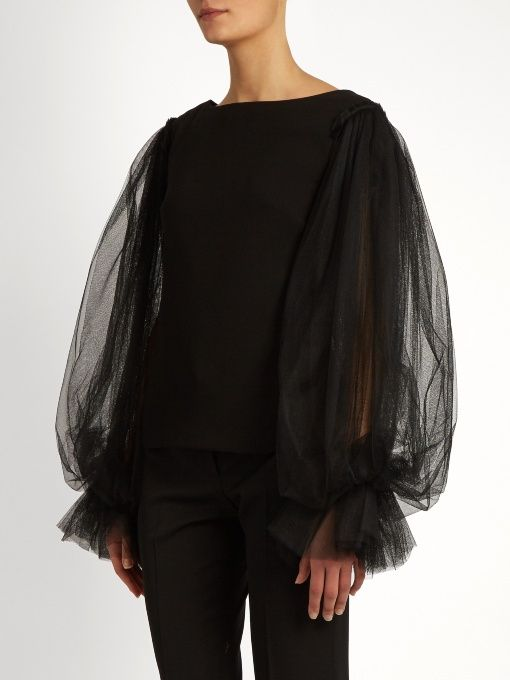 Osman's black crepe Ella top exudes dark romance. It has a slim silhouette that's offset by the voluminous layered tulle balloon sleeves and ruffled cuffs. Wear this satin-lined piece to elevate staple tailored trousers, finishing with barely there heels.