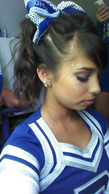 Cheer hair and makeup. Sparkles, bows, and bronzer!