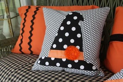 Yes. I said Gdubb pillows...:) @ Tuesdays with Dorie: ...I free handed that cute witches hat and just sewed it on, then trimmed it with some orange ribbon that I've had forever and made that flower by sewing some ribbon in a circle. Whew! Did that ever ma