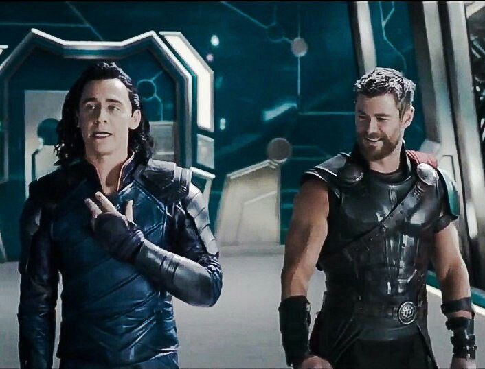 Chris Hemsworth looks like he's checking out Tom's ass