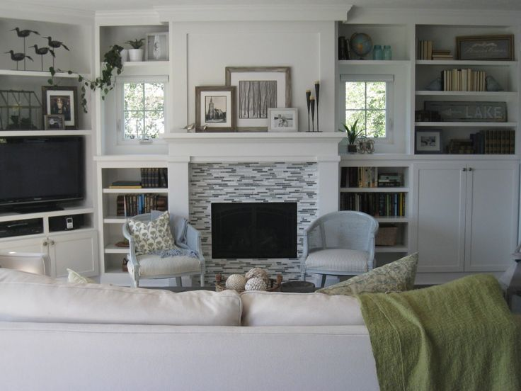 Interior Gray White Fireplace With White Shelf Above Between White Wooden Books Shelves And Storage Connected With Television Storage Gorgeous Fireplace Cabinet Ideas Sweeten Your House Design