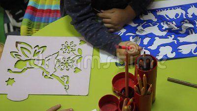Preschoolers to kindergarten during educational activities - drawing with crayons.