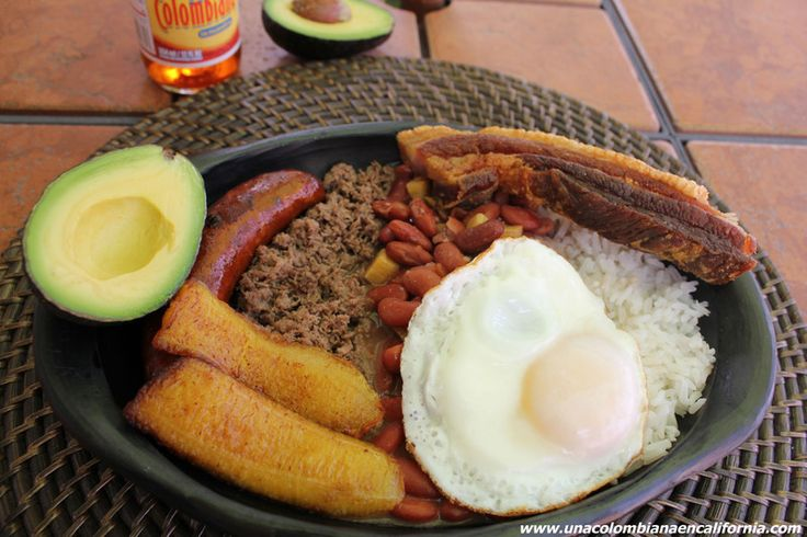 Bandeja paisa - Popular Colombian dish with meat (I'd use steak), chorizo, chicharron, sweet plantain, beans, rice, fried egg, and avocado. In spanish