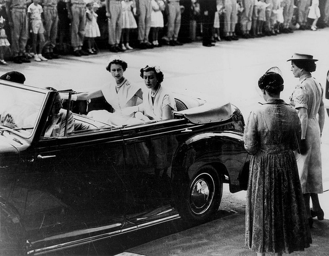 Queen Elizabeth II and her Lady-in-Waiting arrive at a Women's Reception at Brisbane City Hall, 1954 by State Library of Queensland, Australia, via Flickr