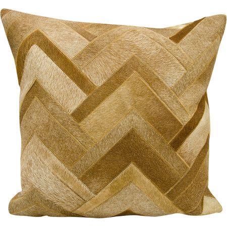 Lend a rustic touch to your sofa or loveseat with this natural hide pillow, awash in a neutral amber hue.Product: Pillow...