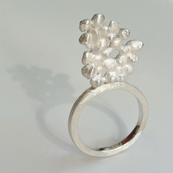 Sterling silver flower inspired ring by ntm. jewellery