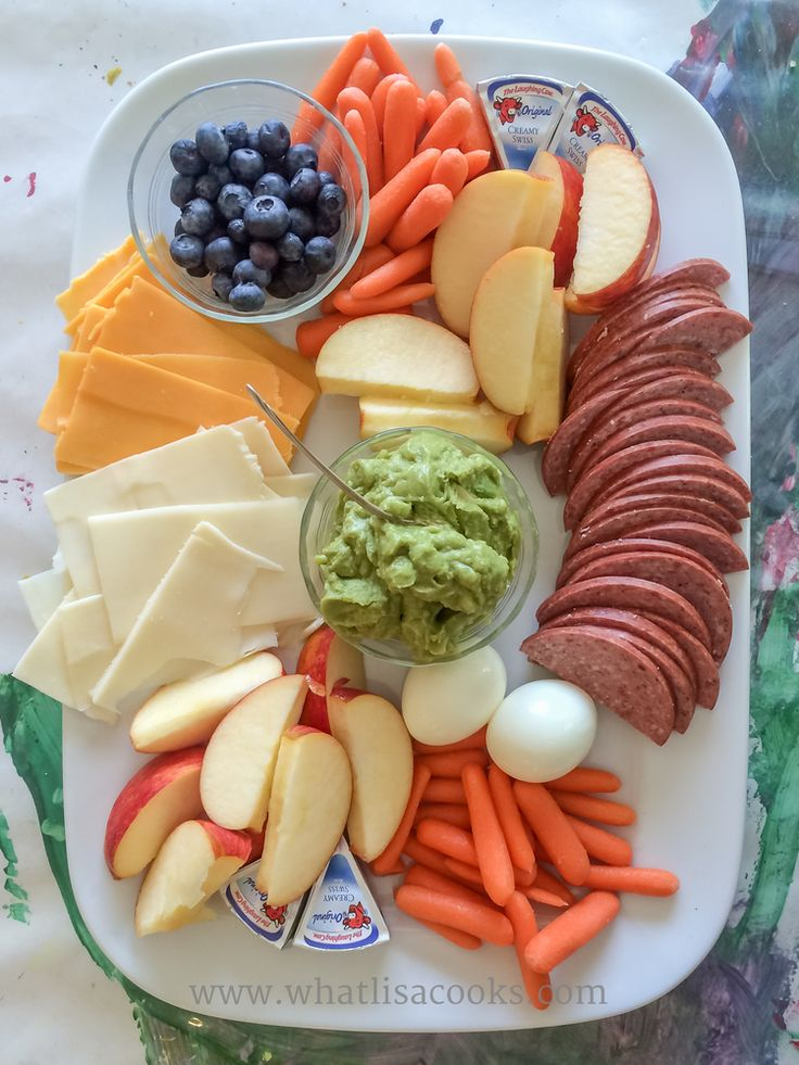 A very typical summer lunch for us - either served on a platter at home, or I packed up a lot of lunches like this for zoo trips and picnics: Salami, carrots, cheeses, apples, berries, boiled eggs, guacamole.
