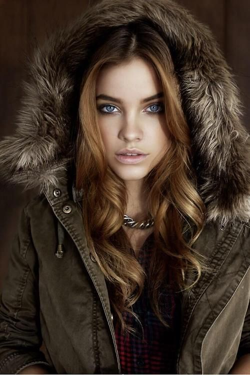 Barbara Palvin. I like the dominant sepia tones of the coat which frames her nice amber colored hair and beautiful face.