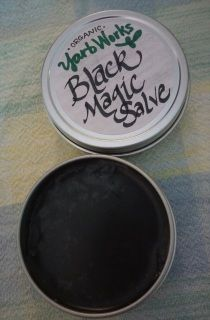 """A """"drawing"""" salve, meant for assisting in pulling things out of the skin, such as foreign objects like stingers, splinters, or bringing acne or boils to a head.  Made with activated charcoal, renowned for its """"detoxing"""" and absorption abilities.  Ingredients: Organic avocado oil, organic black tea leaves, food grade activated charcoal, pure baking soda, beeswax, vitamin E oil, and responsibly wildcrafted pine resin.  Sold in a steel 2 oz screw-top tin."""