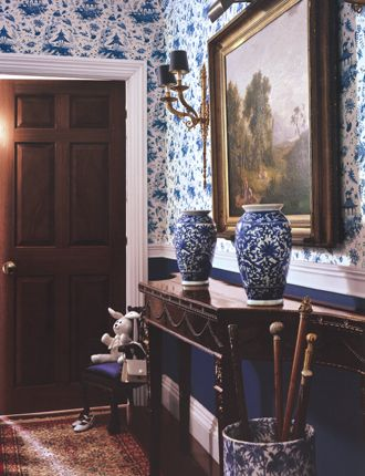 Blue and white walls, porcelain, oil painting, umbrella/walking stick stand, old rug - Ralph Lauren Home
