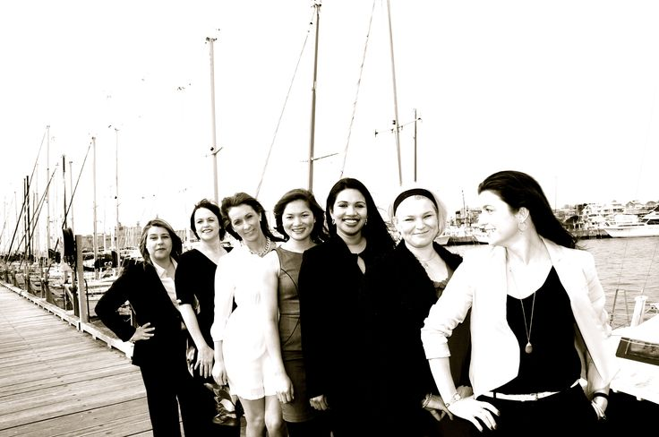 Property Managers pose on a Williamstown jetty.