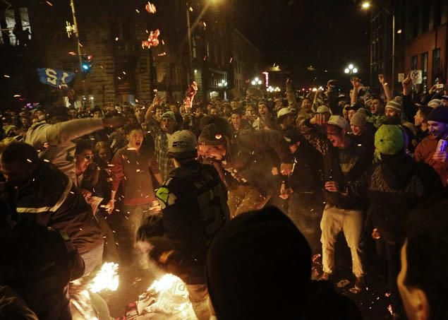 Seattle Seahawks fans celebrate by starting a small fire in the street after their team won the NFL Super Bowl XLVIII in Seattle, Washington...