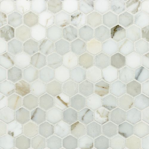 """Welcome to Artistic Tile 1 1/4"""" hexagon calacatta gold honed with Mapei white grout. MECGHHX"""