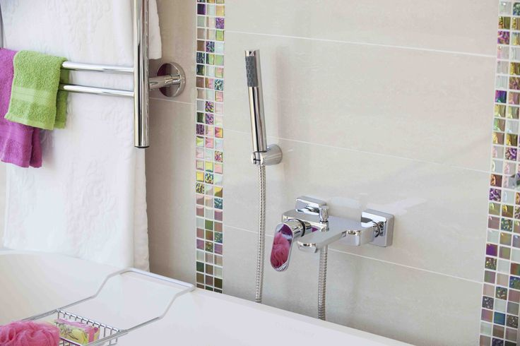 Colourful towels and accessories match brightly coloured and shimmering #mosaic strips beautifully