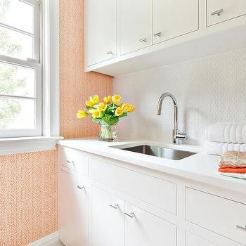 White and Orange Laundry Room with White Penny Tiles