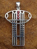 Silver pendant (art nouveau jewelry) inspirated by designs of Scottish designer Charles Rennie Mackintosh. Size circa 2.8 x 4.1 cm. Material: silver 925. Gem: garnet.