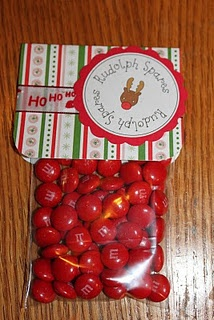rudolph spare nose.. Such a cute idea. I would make Red cake balls and put 6 in a pouch. I like giving more to people I am going to give to