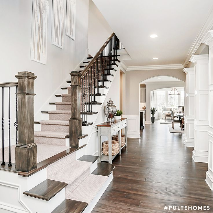Using a color like SW 7015 Repose Gray on the walls of an open entryway like this one, will set a welcoming tone for your family and friends. | Pulte Homes