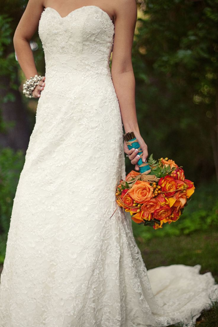 My favorite bouquet love the bright colors but would like some ivory colored flowers as well and camo ribbon where the blue is